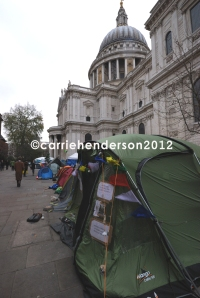 All is still, all is quiet. Office workers leaving for the Christmas holidays ignore the protest village against corporate greed outside St Pauls church in London 2012.